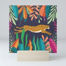Cheetah running in the wild Mini Art Print