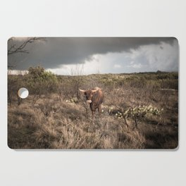Stare Down - A Texas Bull in the Mesquite and Cactus Cutting Board