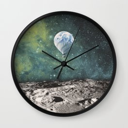 FLOATING THROUGH SPACE Wall Clock