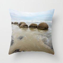 Impressive Moeraki boulders in the Pacific Ocean waves Throw Pillow