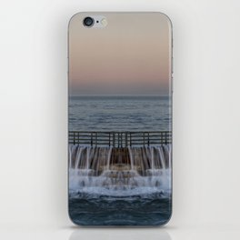 A reflected panorama of a seawall as a wave washes over it in La Jolla, San Diego, California iPhone Skin