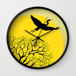 black tree with yellow leaves, sun and heron Wall Clock