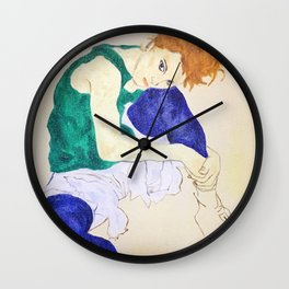 Seated woman with bent knee Wall Clock