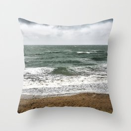 Land and sea under stormy clouds Throw Pillow