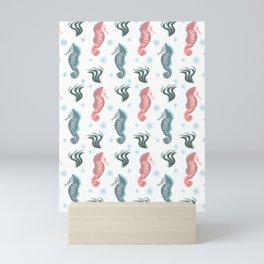 Seahorses in the sea Mini Art Print