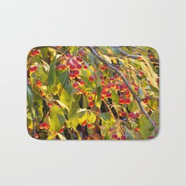 Bright red berries on a tree Bath Mat
