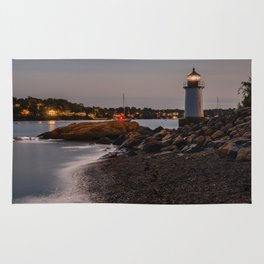 Lighthouse at night Rug