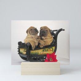 Cute Sharpei in sledge Mini Art Print