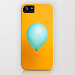 Teal balloon on yellow backdrop iPhone Case