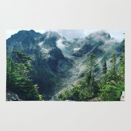 Mountain through the clouds Rug