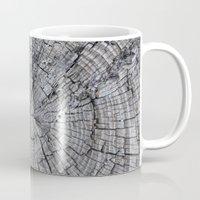 tree rings Mugs featuring Rings by Elizabeth Velasquez