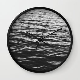 Grain over calm water Wall Clock