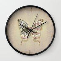 dallas Wall Clocks featuring dallas butterfly by Steffi Louis