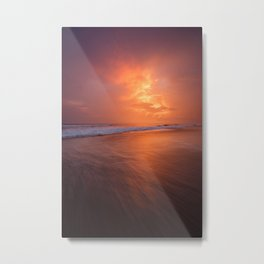 Sunset clouds and waves on empty beach Metal Print