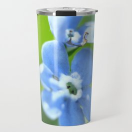 Forget-me-not closeup with blurred focus and shallow depth of field. Travel Mug