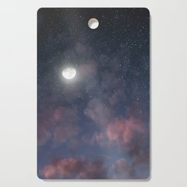 Glowing Moon on the night sky through pink clouds Cutting Board