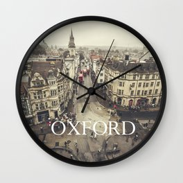 Red buses at Oxford Wall Clock