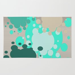 Paint splats in green Rug