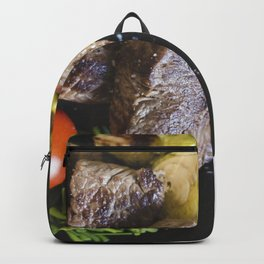 A beef steaks with vegetables Backpack