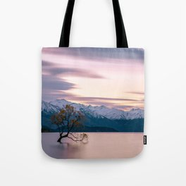 Scenic River with a Solo tree and Mountain Background Tote Bag