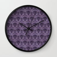 haunted mansion Wall Clocks featuring The Haunted Mansion by GeekCircus
