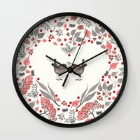 wesley bird Wall Clocks featuring BIRD by Monika Strigel