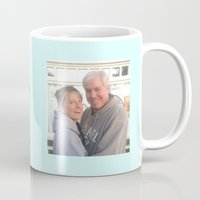 greg guillemin Mugs featuring Greg & Kelly Mug1 by Cheryl Burkhardt