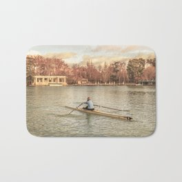 Woman Rowing at Del Retiro Park, Madrid, Spain Bath Mat