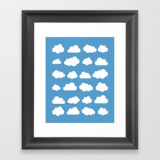 White clouds on a blue skies Framed Art Print