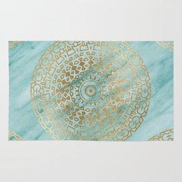 Marble mandala - golden on turquoise marble Rug