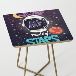 We are all made of stars, typography modern poster design with astronaut helmet and night sky Side Table