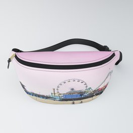 Santa Monica Pier with Ferries Wheel and Roller Coaster Against a Pink Sky Fanny Pack