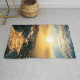 Amazing sunset above clouds and sun lit rocks Rug