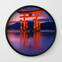 Wonderful sunset colors at the famous floating Torii Gate on Miyagima Island, Japan. Wall Clock