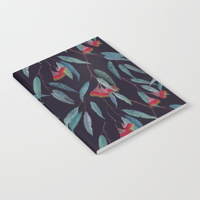 Eucalyptus leaves and flowers on dark violet Notebook