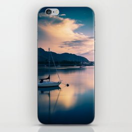 A boat on the river iPhone Skin