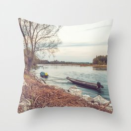Boats moored along the banks of the Ticino river at sunset Throw Pillow
