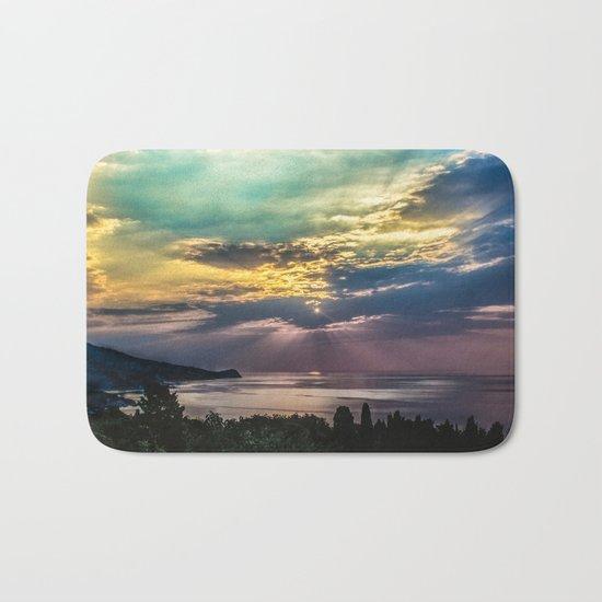Cloudy sunrise Bath Mat