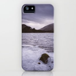 broken ice on the lakeshore. grasmere and helm crag, lake district, uk iPhone Case