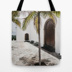 Palm tree growing in the street. La Palma, Canary Island. Tote Bag