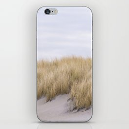 Field of grass growing in the sand iPhone Skin