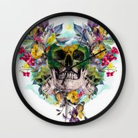 skulls Wall Clocks featuring SKULLS by RIZA PEKER