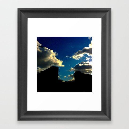 The Clouds above Framed Art Print