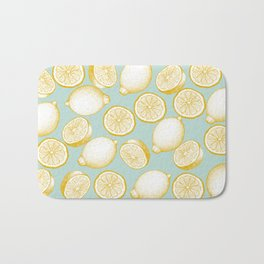 Lemons On Turquoise Background Bath Mat