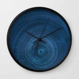 Detailed dark navy blue cut wood tree negative with circle growth rings pattern Wall Clock