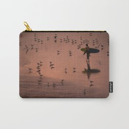 Lone surfer walks along beach at sunset Carry-All Pouch
