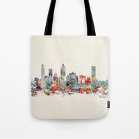 montreal Tote Bags featuring Montreal Quebec skyline by bri.buckley