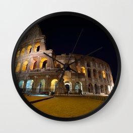 Colosseum illuminated in Rome. Wall Clock