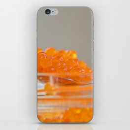 Macro shot of red caviar on jar on a gray background iPhone Skin