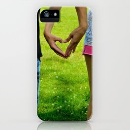 Makers of Love- A couple making a heart with their hands iPhone Case
